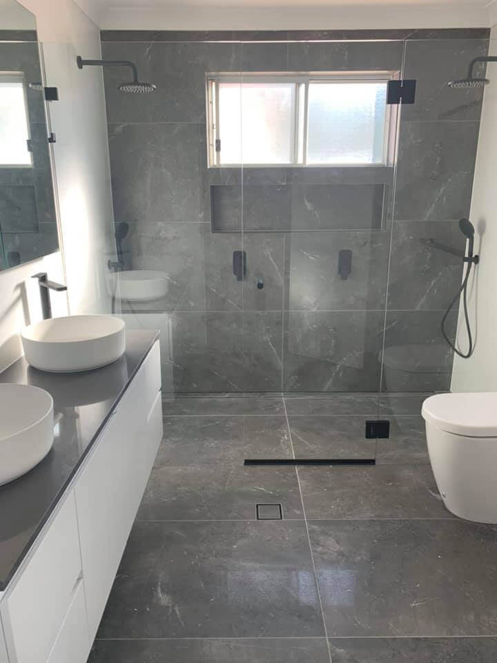 Our happy client Laura with a Style Tile and Bathroom Review